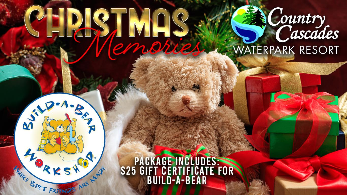 Plush bear set in Christmas decorations and packages. Build-A-Bear logo. Country Cascades logo. Includes $25 gift card.